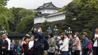 Crowds taking pictures outside the Imperial Palace