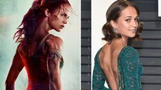 Alicia Vikander on the Tomb Raider poster and in the flesh