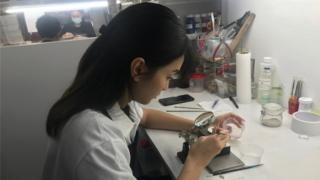 Woman works at medal-maker Royal Insignia