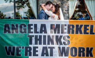 Richie and Orlagh on their wedding day with the flag