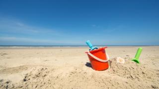 Bucket and spade on a beach