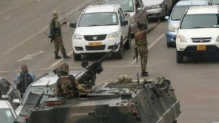 Soldier direct traffic in Harare