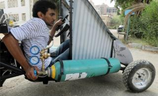 Mahmoud Yasser, mechanical engineering student from Helwan University, drives an air-powered vehicle in Cairo, Egypt - Tuesday 7 August 2018