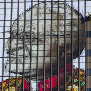 Workers in Cape Town install a giant image of Desmond Tutu, South Africa's Nobel Peace laureate, a celebration of his dedication to society.