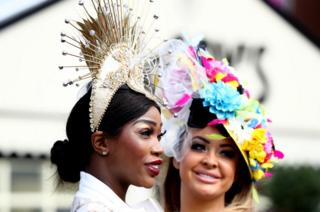 Women with expensive hats at Aintree on Ladies Day