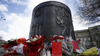 Floral tributes left at a Hillsborough memorial in Old Haymarket, Liverpool,