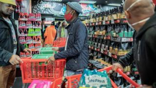 in_pictures Customers buy alcohol at a liquor shop in Melville, Johannesburg