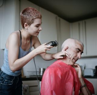 Molly shaves her dad's head