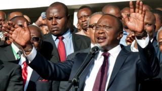 """Uhuru Kenyatta (C) speaks following his victory in Kenya""""s national elections in Nairobi on March 9, 2013."""