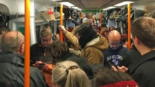 Commuters on a crowded train
