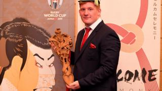 Rhys Carre and the Wales team's traditional Welsh lovespoon