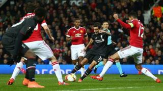 Philippe Coutinho of Liverpool is blocked by Chris Smalling of Manchester United