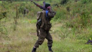 Congolese army soldier walks at the frontline, November 12, 2008 in the outskirts of the town of Goma, DR Congo.