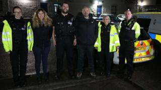 G999 team members from the police and charity standing in a row