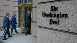 The Washington post logo emblazoned on their building in Washington DC