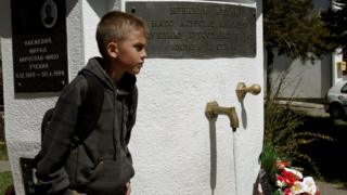A child passes by a commemorative for a victims of NATOs 1999 bombing before a criticism described as a together parliament, forward of Apr 28s council opinion to sanction Montenegros NATO membership, in a encampment of Murino, Montenegro