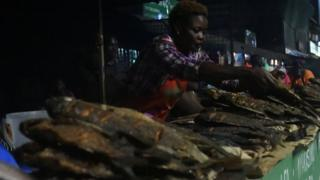 A woman at the Nairobi West fish mongers sell freshly caught and cooked fish on September 18, 2019 in Nairobi.