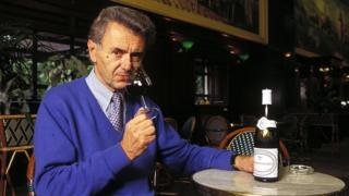Georges Duboeuf drinking a glass of Beaujolais in 1995