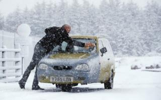 in_pictures The owner of a three-wheeled Reliant Robin car battles snow