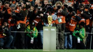 Photographers take pictures of the World Cup trophy prior to the start of the 2010 World Cup final football match Netherlands versus Spain on July 11, 2010 at Soccer City stadium in Soweto, a suburb of Johannesburg