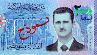 Асад на купюре