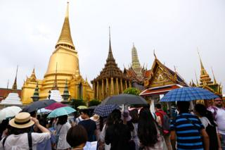 A Chinese tourist group visits the Emerald Buddha Temple inside the Grand Palace in Bangkok, Thailand, 23 September 2017