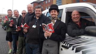 Taxi drivers reading Dickens