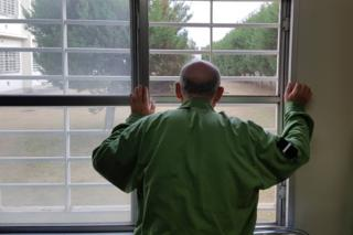 Japanese prisoner looking through bars