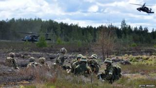 UK soldiers take part in a military exercise in Latvia on 10 June 2015