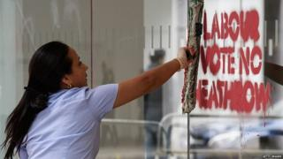 Anti-expansion graffiti daubed on Labour's headquarters in London being removed