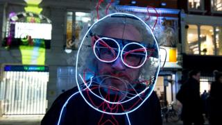 Man in light-up fancy dress
