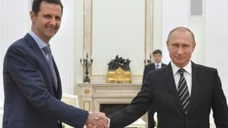 Bashar al-Assad and Vladimir Putin shaking hands
