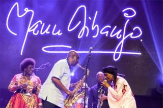 "Manu Dibango, saxophonist and Franco-Cameroonian singer of world jazz, performs during his concert on June 29, 2018 at the Ivory Hotel Abidjan. Saxophonist Manu Dibango, who plays ""Baobab"" African music, celebrates his 60 years of music, giving a unique concert in Abidjan, following his successful return to the Ivory Coast where he used to play in the 1970s"