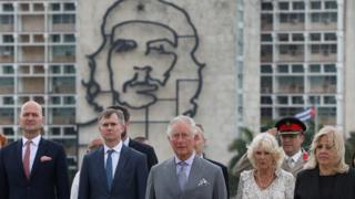 "Prince Charles and Camilla standing near an image of late revolutionary hero Ernesto ""Che"" Guevara"