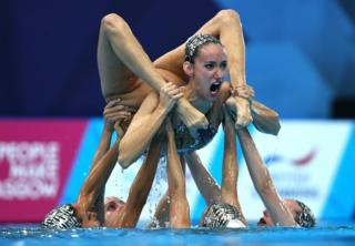 Swimmers compete in the Synchronised Swimming Team Free Routine final