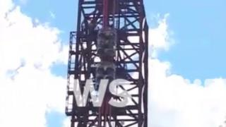Passengers trapped on the BuzzSaw rollercoaster ride at Dreamworld