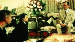 TV grab of King Bhumibol (right) with rivals Gen Suchinda Kraprayoon (centre) and Chamlong Srimuang at the Royal Palace on 20 May 1992