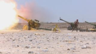 Shia militia fire artillery outside the Iraqi city of Falluja