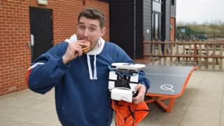Image of Tom eating burger taken from Colchester United's Twitter page