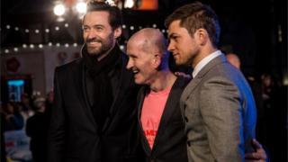 Hugh Jackman, Eddie Edwards and Taron Egerton at the UK premiere