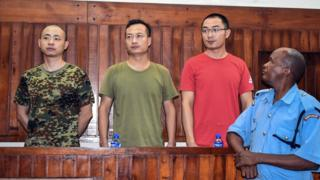 "Chinese employees of China Roads and Bridge Corporation at the Standard Gauge Railway (SGR), security manager Li Gen (L), security magager Li Xiaowu (2ndL) and translator Sun Xin (2ndR) appear on November 26, 2018 at Mombasa""s Court, Kenya, charged with bribery."