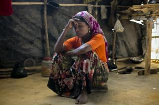 A Rohingya woman in the makeshift house she shares with 6 other refugees at a refugee camp in Cox's Bazar, Bangladesh.