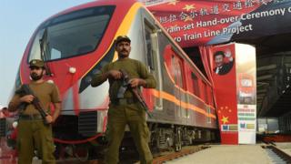 Pakistani policemen stand guard during the unveiling ceremony of the first set of carriages of Lahore Orange Line MetroTrain in Lahore on October 8, 2017.