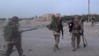 Image released by IS-linked media outlet, purporting to show the battle for the town