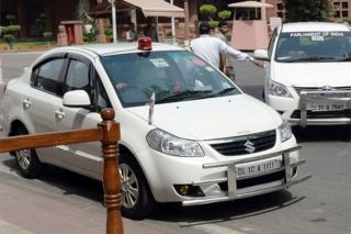 "This file photo taken on May 8, 2015 shows an Indian politician""s car with a red beacon on it outside Parliament House in New Delh"