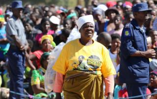 Supporters of Zimbabwean President Robert Mugabe attend a rally in Marondera, Zimbabwe,