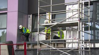 Work to remove cladding