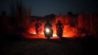 Cow vigilantes on motorbikes in Yadavnagar, Rajasthan