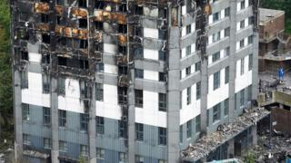 Close up of the charred remains of Grenfell Tower after the blaze