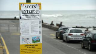 A board informing that the access to Alcyons beach is forbidden is displayed in Guethary southwestern France, on May 12, 2020